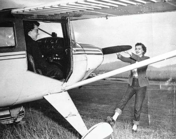 Janet Bailey, at right, at Lebanon Airport in the 1950s. Bailey, who is now 82, trained to become a pilot and logged several hours of solo flights in the '50s, but her father disapproved and she abandoned those dreams. (Courtesy photograph)